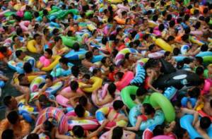 Locals flock to community pool to seek relief from the heat.