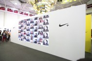 Runners view their image from the NIKE photo booth sharing why they run.