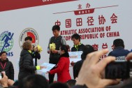 "Presenting ""checks"" to the 1/2 marathon winners."