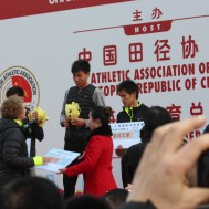 "Presenting ""checks"" to the 1/2 marathon winners."