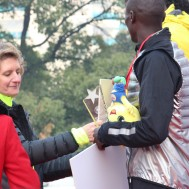"Presenting ""checks"" to the marathon winners from Ethiopia and South Africa."