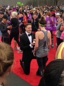 Matt purposes to Leanne at the finish of the NIKE Women's 1/2 Marathon.