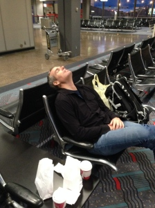 Pretending to sleep to avoid my complaining about the flight delay.